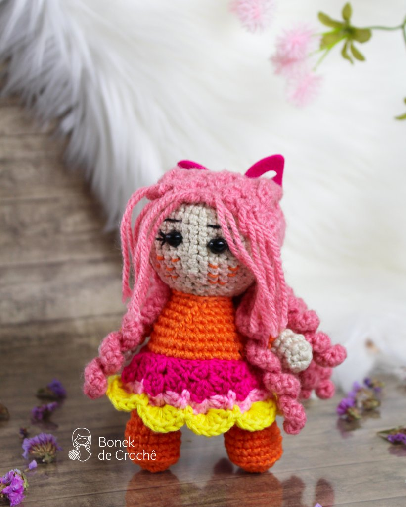 Molly is a unique, beautiful and smart, hand knit doll soft colorful yarn, filled with non-allergenic of holofiber.